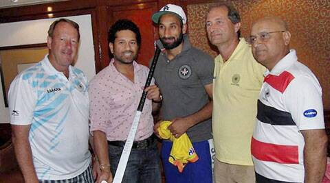 Sachin Tendulkar with Sardar Singh and hockey team staff members in New Delhi on Tuesday. (PTI)