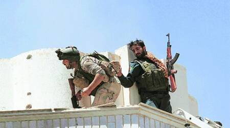 Afghan forces take positions during the 9-hour firefight in Herat on Friday. ( Source: Reuters )