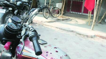 Blood spots on motobike of a CPM supporter, in Kolkata Sunday. (Partha Paul)