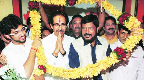 Shiv Sena chief Uddhav Thackeray being felicitated by RPI chief Ramdas Athawale (right) at Sena Bhavan in Dadar on Friday.
