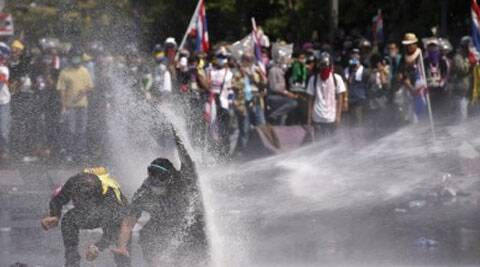 "Thai police fired water cannons and tear gas at opposition protesters who launched an ""all out final battle"" to topple the government. (AP)"