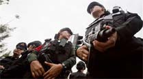 Thailand troops detain Cabinet minister who blasted coup
