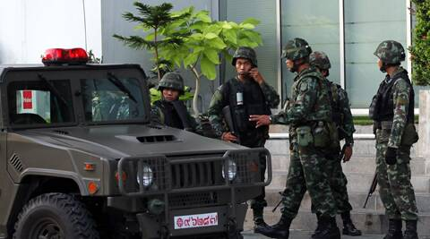 Thai soldiers gather outside the National Broadcasting Services of Thailand in Bangkok, Thailand. Thailand's army declared martial law in a surprise announcement in Bangkok before dawn on Tuesday, intensifying the turbulent nation's deepening political crisis. The military, however, denied a coup d'etat was underway. (AP Photo/Apichart Weerawong)