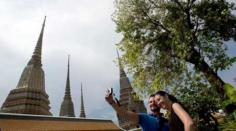 Tourists are kicking back on the country's famed beaches and sightseeing in Bangkok. (Source: AP)