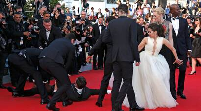 Man dives under America Ferrera's dress on Cannes red carpet