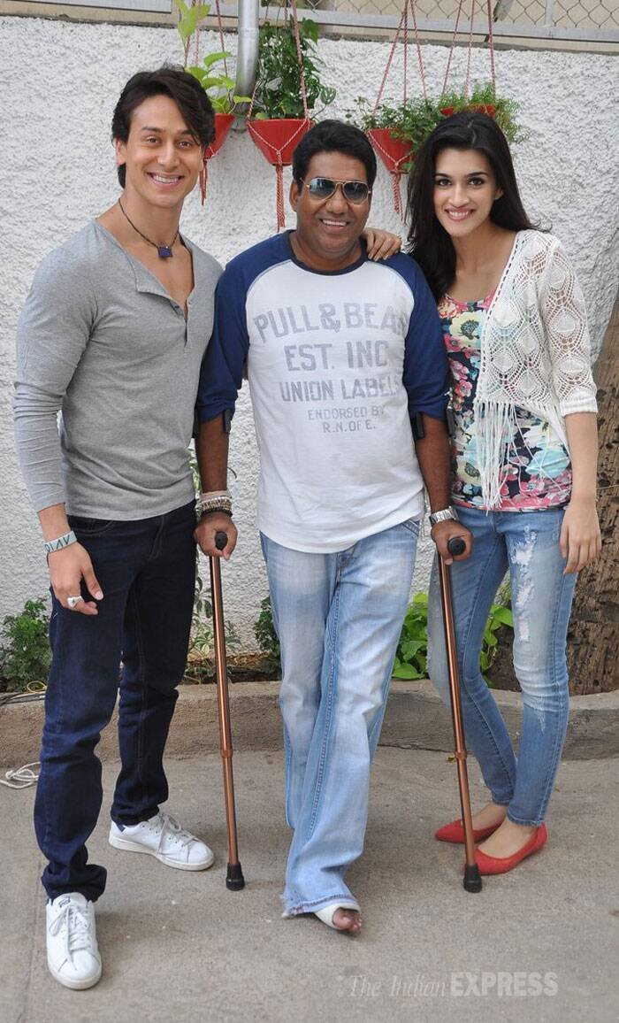 Tiger and Kriti smile for a picture along with their director Sabbir Khan who is currently suffering from a foot injury. (Source: Varinder Chawla)
