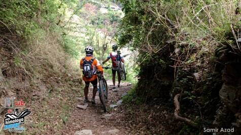 Riders go down a technical downhill section. Most riders carried their bikes on their shoulders down these slopes. (Picture: HASTPA)