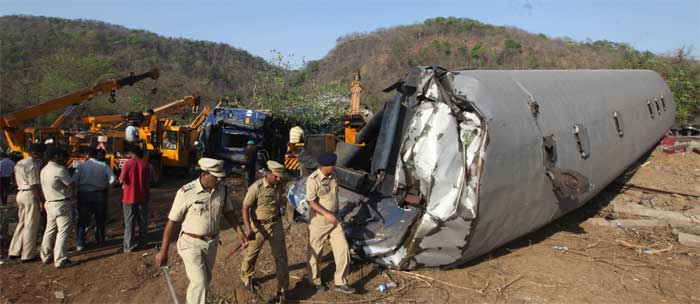 The accident occurred just outside a tunnel near Nidi village, when the engine and four out of 20 bogies of Diwa-Sawantwadi passenger train derailed between Nagothane and Roha railway stations, about 120 km from Mumbai. (Express Photo: Prashant Nadkar)