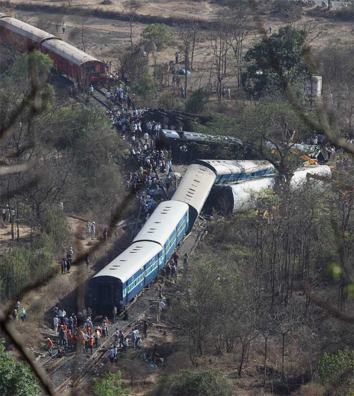 The incident occurred just outside a tunnel near Nidi village, when the engine of Diwa-Sawantwadi passenger train and four bogies derailed at around 10 AM between Nagothane and Roha railway stations. (Express Photo: Prakash Nadkar)