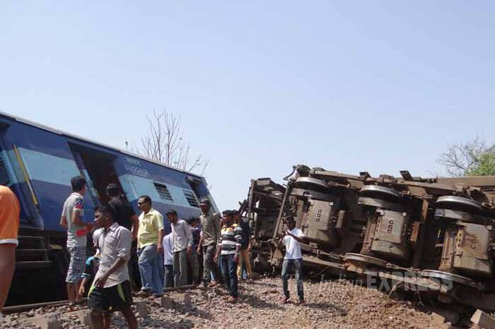 The rescuers used gas cutters to open the derailed coaches to reach those trapped inside. (Express Photo)