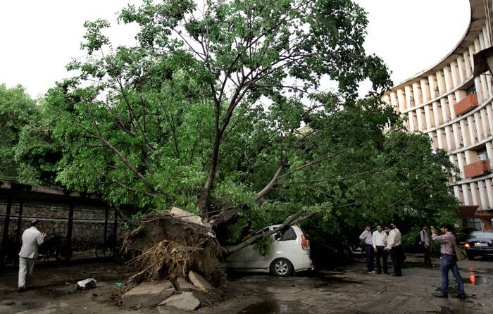 At least nine people were killed in the NCR region, including six in Delhi, as a massive thunder storm lashed the region crippling road traffic, metro services and flight operations and hitting power supply. (Source: Express photo by Ravi Kanojia)