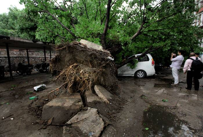 Delhi Police said six people died and 13 were injured in various areas of the city in accidents like felling of trees, collapse of walls and electrocution following the storm which was accompanied by winds at a speed of over 90 kmph. (Source: Express photo by Ravi Kanojia)