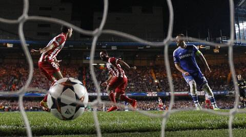 Arda Turan scores his Atletico Madrid's third and final goal of the night in Stamford Bridge to give his side a 3-1 win over Chelsea in the Champions League semi-final. (Reuters)
