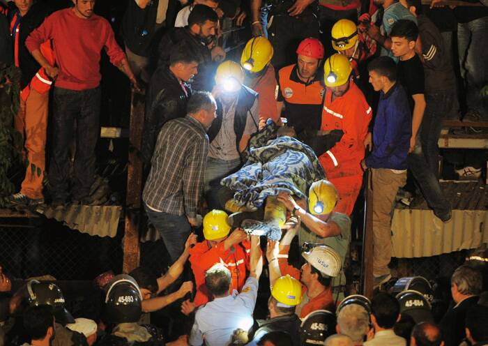 Energy Minister Taner Yildiz said 787 people were inside the coal mine in Soma, some 250 kilometers (155 miles) south of Istanbul, at the time of the accident and 363 of them had been rescued so far. <br />Miners carry a rescued friend after an explosion and fire at a coal mine. (Source: AP)