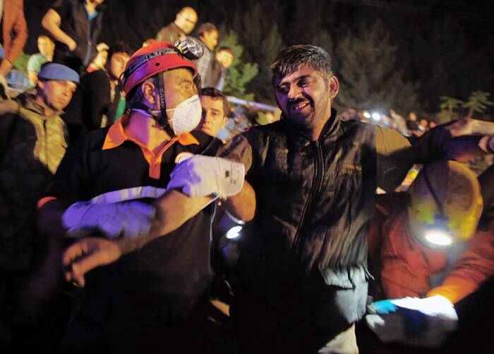 At least 80 miners were injured, including four who were in serious condition, Yildiz told reporters in Soma, as he oversaw the rescue operation involving more than 400 rescuers.<br />Miners help a rescued friend hours after an explosion and fire at a coal mine. (Source: AP)