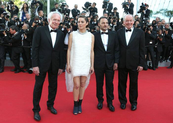 The cast of 'Two Days, One Night' – Directors Luc Dardenne, Jean-Pierre Dardenne along with actors Marion Cotillard and Fabrizio Rongione. The film is said to tell the tale of a woman who tries to convince her colleagues to give up their bonuses, so that she can keep her job. (Source: AP )