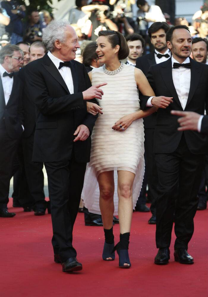 Marion Cotillard once again surprised us on the red carpet in a white Christina Dior Couture spring 2014 with chunky peep-toe heels as she arrived along with her co-star Fabrizio Rongione and director Jean-Pierre Dardenne for the premiere of their film, 'Two Days, One Night'. (Source: AP)