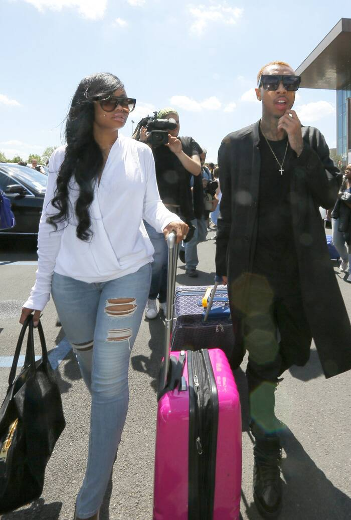 West, 36, proposed to Kardashian, 33, in October on her birthday. He rented out San Francisco's AT&T Park to pop the question. <br />American rapper Tyga, right, arrives in Florence, Italy. (Source: AP)