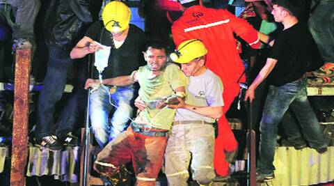 An injured miner is carried to an ambulance after being rescued. ( Source: Reuters )