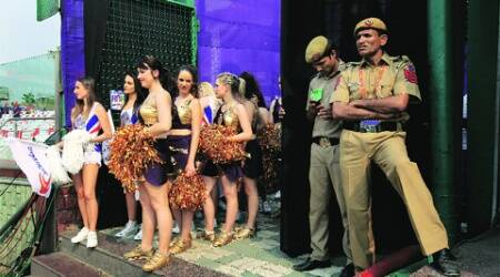 Cheerleaders wait for their cue to enter the ground before the beginning of an IPL match at Feroze Shah Kotla stadium in the capital. (Ravi Kanojia)