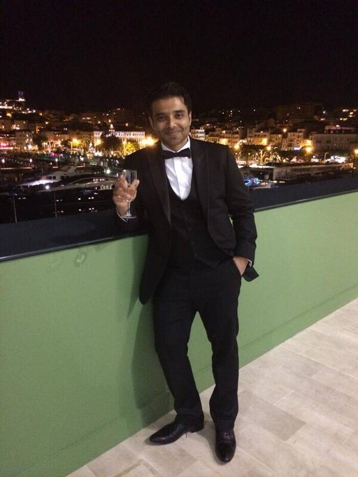 The 'Dhoom' actor looks dapper in a tuxedo with a bowtie as he enjoys a drink celebrating the grand opening that the 'Grace of Monaco' received at the 67th Cannes Film Festival. (Source: Twitter)