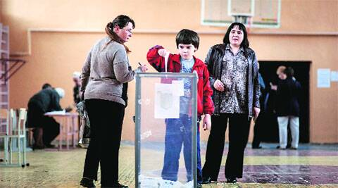 Local residents cast their ballots at a polling station in Luhansk.  AP