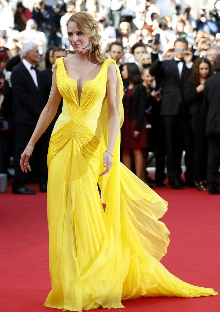 Actress Uma Thurman was a ray of sunshine of the red carpet looking glamourous in yellow flowy gown as she arrived for the premiere of 'Clouds of Sils Maria'. (Source: AP)