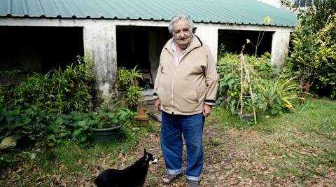 Uruguay's President Jose Mujica poses for a photo with his dog, Manuela, at his home on the outskirts of Montevideo, Uruguay. (AP)