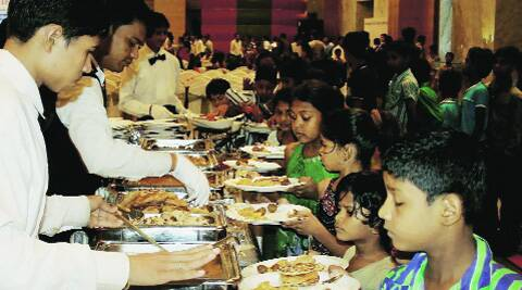 Children of an orphanage having lunch organised by a Narendra Modi supporter at a five-star hotel in Surat on Sunday. ( Source: PTI )