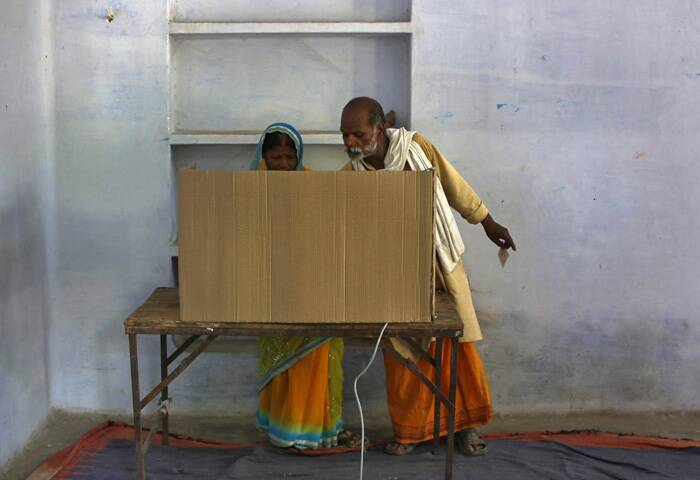 A couple cast their vote at a polling station in the final phase of the general election in Varanasi. ( Source: Reuters )