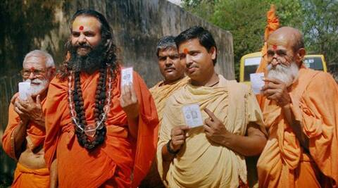 Sadhus after casting their votes for the last phase of Lok Sabha elections in Varanasi on Monday. PTI Photo