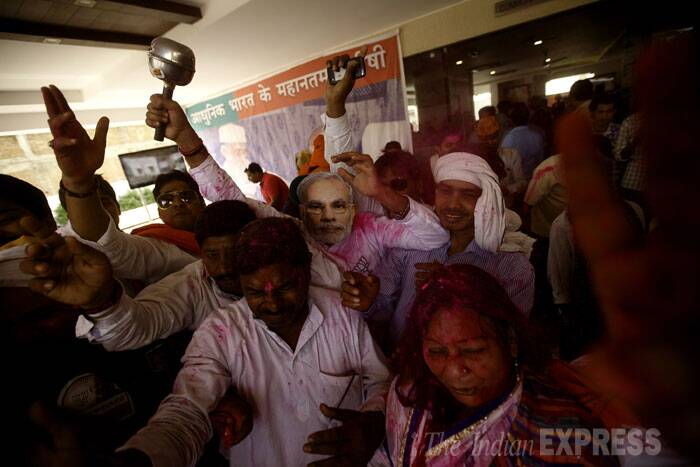 BJP workers are seen celebrating their victory in Varanasi on Friday. (Source: Express photo by Praveen Khanna)