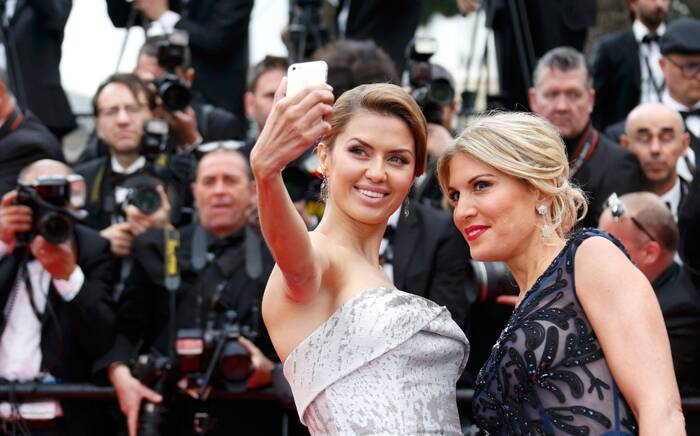 Model and TV presenter Victoria Bonya and spokesmodel and Fashion Presenter Hofit Golan click a selfie as they arrive for the 67th Cannes Film Festival and the screening of the 'Grace of Monaco'. (Source: Reuters)