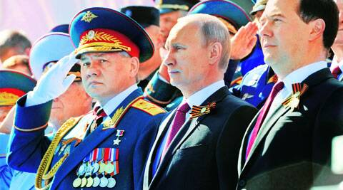 President Vladimir Putin, PM Dmitry Medvedev (right) and Defence Minister Sergei Shoigu at Victory Day parade in Moscow's Red Square Friday. Reuters