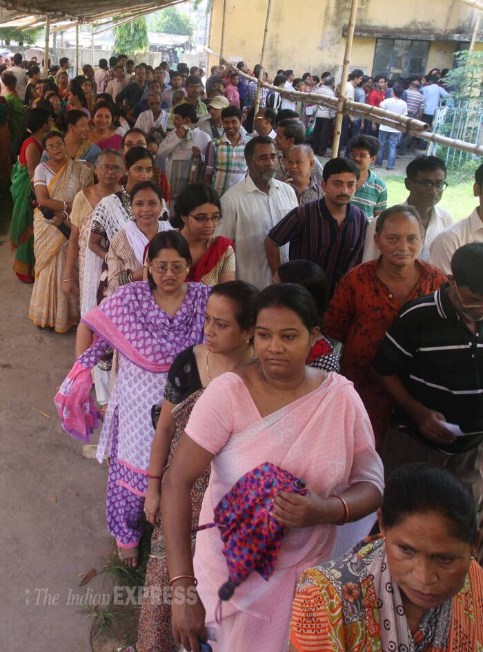 Voters queue up outside a polling booth in Salt lake Kolkata to exercise their franchise on Monday. ( Source: Express photo by Partha Paul )