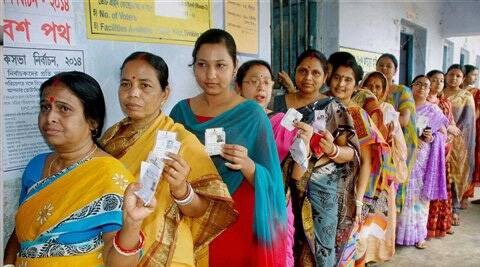 Bankura :Women voters showing their voter identity cards as they wait in a queue to cast their vote at a polling booth at Bankura district in West Bengal on Wednesday.PTI Photo