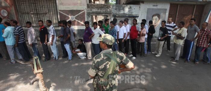 Security personnel keeps a strict vigil at a polling station in Kolkata. ( Source: Express photo by Partha Paul )