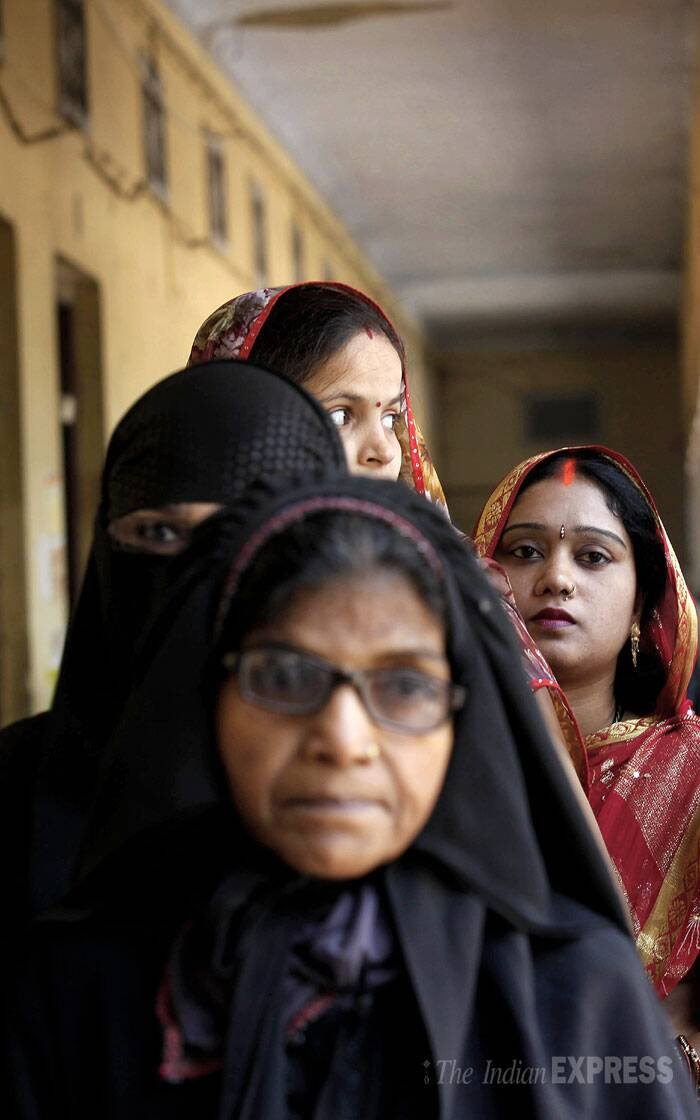 Hindu and muslim women stand in a queue to cast their vote at a polling in Varanasi. ( Source: Neeraj Priyadarshi )