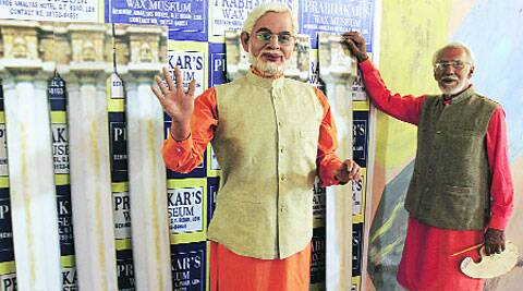 Parbhakar with the wax statue. ( Source: Express photo by Gurmeet Singh )