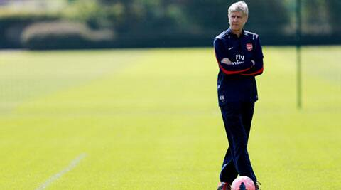 Arsenal manager Arsene Wenger, pauses during a training session with his team, in London  on Wednesday. Arsenal are playing Hull City in the FA Cup final on Saturday. (AP)