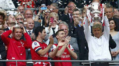 Arsene Wenger lifts the FA Cup, the win ending Arsenal's nine-year wait for silverware. (Reuters)