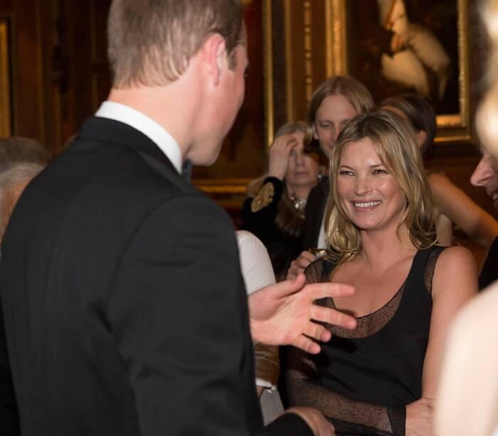 Kate Moss flashes a smile as the Duke of Cambridge speaks to her. ( Source: AP )