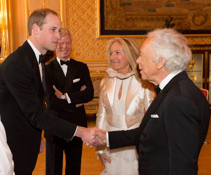 William shakes hands with designer Ralph Lauren as he arrives with his wife Ricky Anne. ( Source: AP )
