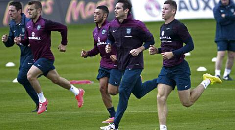 England's Jack Wilshere (second left) attends a training session with fellow team-mates in Vale do Lobo, southern Portugal on Wednesday, May 21 2014. (Source: AP)
