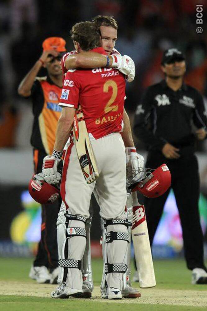 Kings XI Punjab's David Miller hugs his skipper George Bailey after the latter sealed an emphatic victory at the Rajiv Gandhi International Stadium in Hyderabad with a six over long-off. The win propelled Kings XI Punjab's to the top of IPL 7 rankings. (Photo: IPL/BCCI)