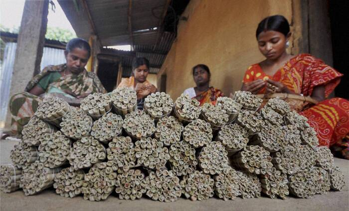 A woman worker prepares beedis, or leaf-made cigarettes at her workplace in Agartala, Tripura on International Labour Day. (PTI)