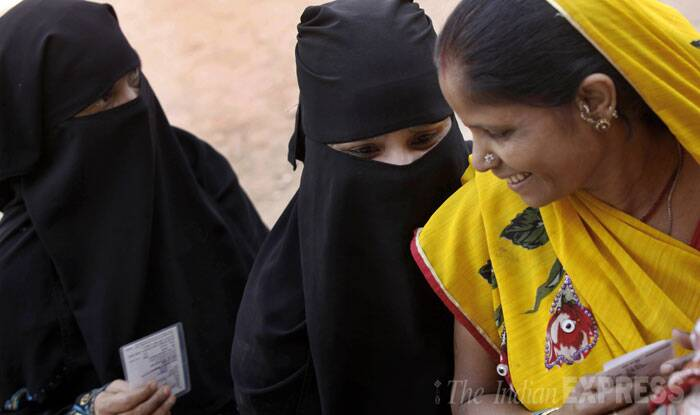 Women stand in a queue to cast their vote at a polling in Varanasi. ( Source: Neeraj Priyadarshi )