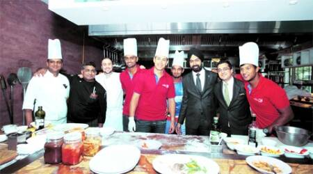JW Marriott team with the Delhi Daredevils players, who were at the hotel for a cook-off; Chef Daniel Triver and batsman Ross Taylor