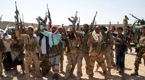 Yemen's army soldiers hold up their weapons at an area seized from al-Qaida in the southeastern province of Shabwa, Yemen. (AP)
