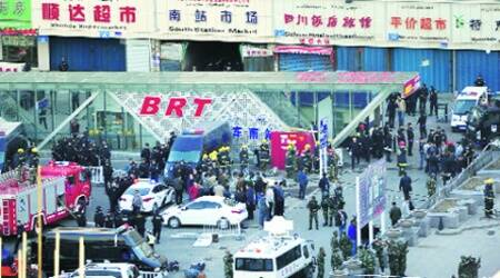 Security personnel at the scene of the explosion in Urumqi Wednesday. (AP)